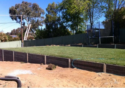 Concrete sleepers, hardy grass and landscape in progress