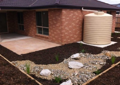 Low maintenance garden with dry river bed
