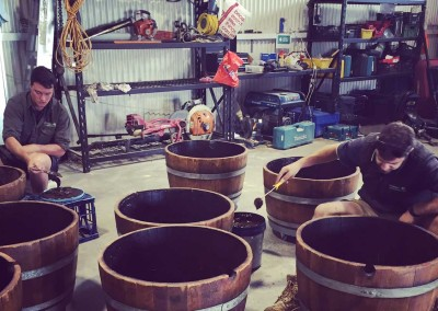 Preparing wine barrels for planting | Phillips Landscapes Canberra