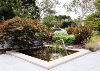 Front garden design with a water feature