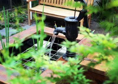 Creative water feature and complementary planting