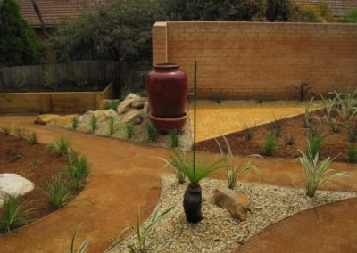 Grass trees and pavers in Evatt