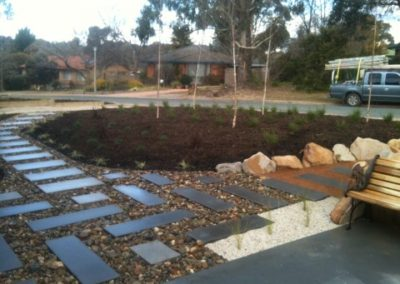 Pavers set in river pebbles for a front garden